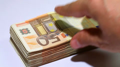 Spending Money. Timelapse video hand taking fifty euro notes - stock footage