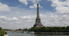 Ultra HD 4K Eiffel Tower Paris Skyline Busy City Touristic Tour Boats Passing Stock Footage