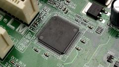 Zoom out of motherboard chip Stock Footage