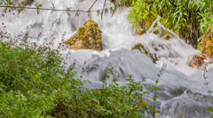 Mountain spring waterfall coming down Stock Footage