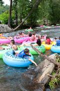 families go tubing down north georgia river - stock photo