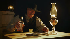 Cowboy pouring whiskey Stock Footage