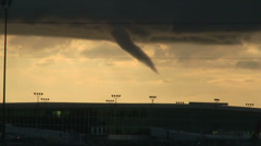 Funnel cloud over buildings Stock Footage
