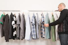 Man in a clothes shop Stock Photos