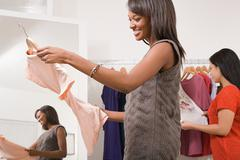 Women in clothes shop Stock Photos