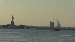 Old Sailing ship and statue of Liberty. Stock Footage