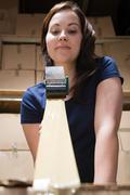 Woman taping up box - stock photo
