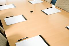 Notepads on conference table Stock Photos