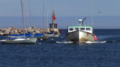 Fishing boat entering Rockport harbor, Maine Stock Footage