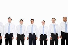 Similar looking businessmen in a row - stock photo