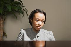 Business woman looking worried - stock photo