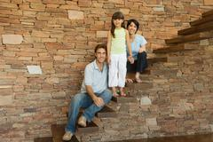 Girl and parents on stairs - stock photo