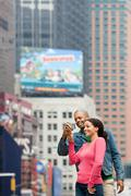 Couple using digital camera - stock photo