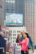 Couple using digital camera Stock Photos