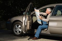 Man looking at map Stock Photos