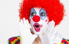 clown yelling extreme close up bright beautiful female performer - stock photo