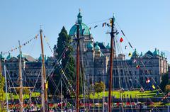 Stock Photo of provincial capital legislative buildiing wooden boats inner harbor british co