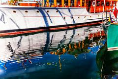 Stock Photo of wooden boats reflection abstract inner harbor british columbia canada
