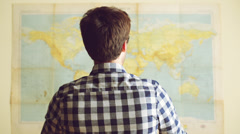 Young man plans to take over the world Stock Footage