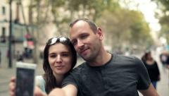 Young couple taking photo with cellphone in the city HD - stock footage