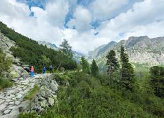 high tatras (slovakia) summer view and family on footway. - stock photo