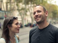 Young happy couple talking in the city NTSC Stock Footage