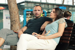 Young couple talking and relaxing on bench in shopping mal NTSC Stock Footage