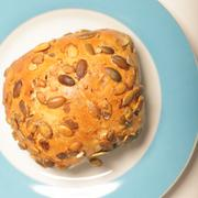 crusty roll with sunflower seeds - stock photo