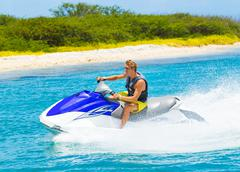 young man on jet ski - stock photo