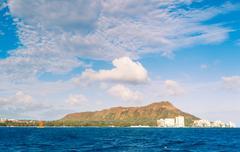 honolulu city skyline from water - stock photo