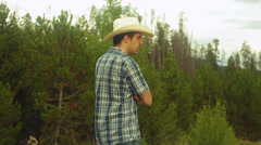rancher checking property border 2 tracks tracking - stock footage