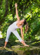 woman practacing yoga in nature - stock photo