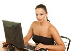 Pretty business woman at office desk Stock Photos