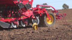 Agriculture machine sowing seeds and cultivating field Stock Footage