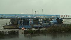 Fishing Boats Shelter In Port During Hurricane - stock footage