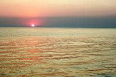 Sunset over the sea bay Stock Photos