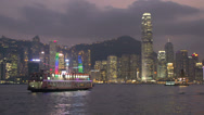 Stock Video Footage of Cruiseship in front of Hong Kong skyline at night