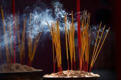 Burning incense sticks Stock Photos