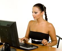 pretty caucasian business woman at office desk - stock photo