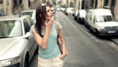 Beautiful lost, confused woman in the city HD Stock Footage