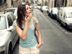 Beautiful lost, confused woman in the city NTSC Stock Footage