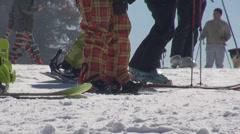 Details people skier snowboarder equipment ski dog mountain resort snow alps - stock footage