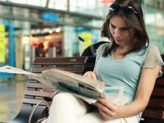 Beautiful woman reading newspaper in shopping mall NTSC Stock Footage