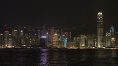 Hong Kong skyline light show with cruiseship arriving Stock Footage