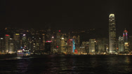 Stock Video Footage of Hong Kong skyline light show with cruiseship passing by