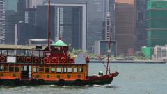 205 Skyscapers at Victoria's harbor and Star Ferry, Hong Kong Stock Footage
