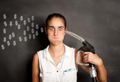 young woman with a fuel pump nozzle - stock illustration