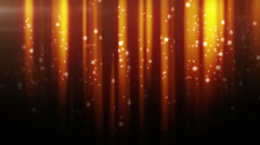 Gold particles flying in light beams loop Stock Footage