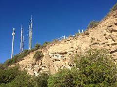 Mini Powerstation Overlooking a Cliff Face - stock photo