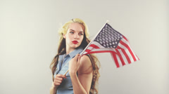 Patriotic woman holding american flag for independence day Stock Footage